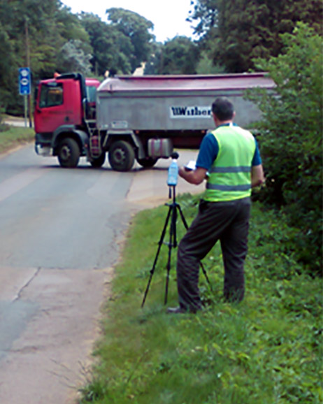 Tim measuring Sound Exposure Level (SEL) measurements of lorries turning into and out of the processing plant